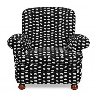 Fotelj 336 iz leta 1934; vzorec blaga je delo Estrid Ericson, tedanje lastnice podjetja Svenskt Tenn.