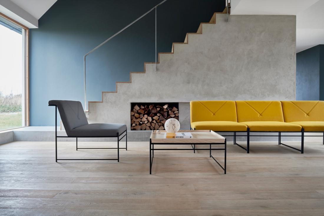 Kombinacija sive in rumena ni nova, v interierjih je to pogosta izbira. FOTO: arhiv podjetja Blä Station